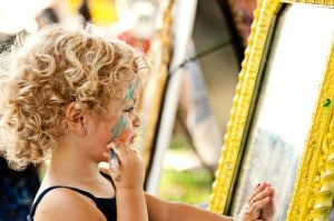 Young girl putting on makeup